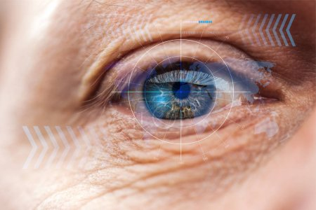 Photo for Close up view of mature human eye with data illustration, robotic concept - Royalty Free Image