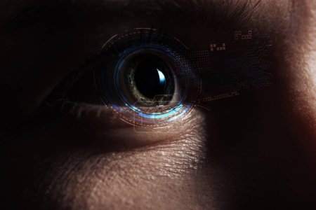 Photo for Close up view of human eye with data illustration in darkness, robotic concept - Royalty Free Image
