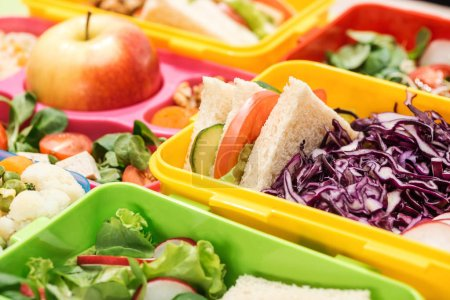 Photo for Close up view of tasty food in lunch boxes - Royalty Free Image