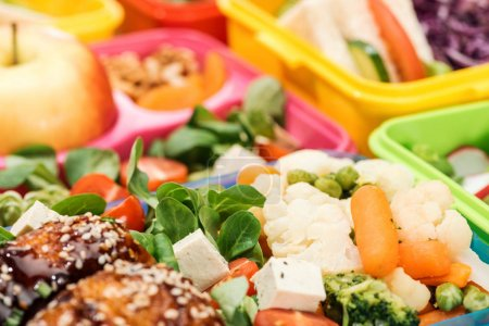 Photo for Close up view of fresh delicious food in lunch boxes - Royalty Free Image