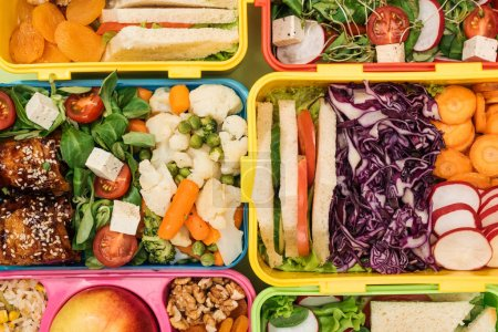 Photo for Top view of lunch boxes with nutritious food - Royalty Free Image