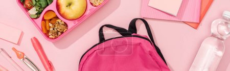 Photo for Panoramic shot of lunch box with food near backpack and stationery - Royalty Free Image
