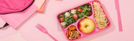 Photo for Panoramic shot of lunch box with food near fork, backpack and stationery - Royalty Free Image