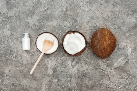 Photo for Flat lay with coconuts and coconut cream on grey textured background - Royalty Free Image