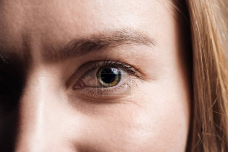 close up view of young woman colorful eye