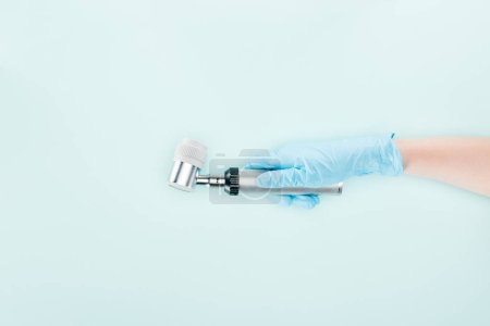Photo for Cropped view of doctor in latex glove holding dermatoscope isolated on blue - Royalty Free Image