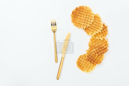Photo for Top view of waffles and fork with knife isolated on white - Royalty Free Image