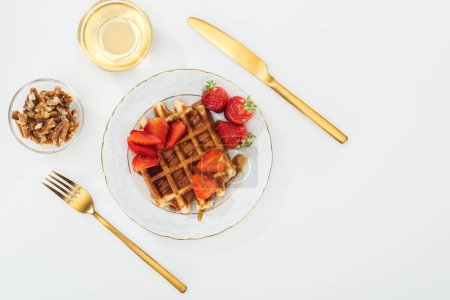 Photo for Flat lay with waffles and strawberries on plate near bowls on white - Royalty Free Image