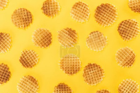 Photo for Top view of crispy waffles isolated on yellow - Royalty Free Image