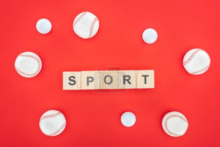 Photo for Sport lettering on wooden cubes near softballs isolated on red - Royalty Free Image