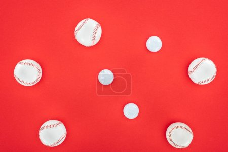 top view of white and leather softballs isolated on red