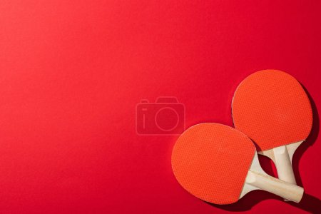 Photo for Top view of table tennis rackets isolated on red - Royalty Free Image