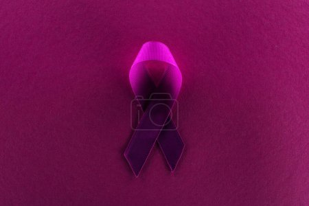 Photo for Top view of purple ribbon on purple background in shadow - Royalty Free Image