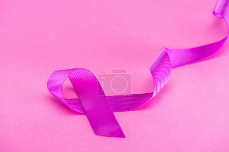 Photo for Purple ribbon on pink background, violence concept - Royalty Free Image