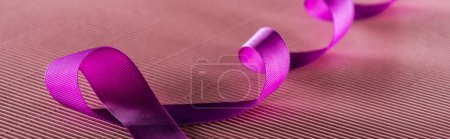 Photo for Panoramic shot of purple ribbon on pink texture background in shadow, violence concept - Royalty Free Image