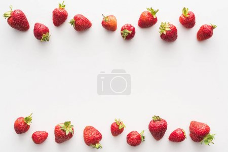 Photo for Top view of sweet and red strawberries on white background - Royalty Free Image