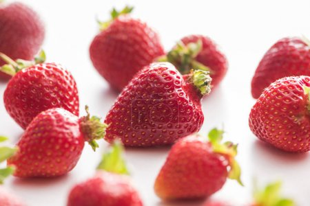 Photo for Selective focus of whole and red strawberries on white background - Royalty Free Image