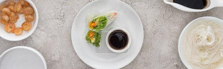 Photo for Panoramic shot of tasty and served spring rolls with soy sauce on white plate - Royalty Free Image