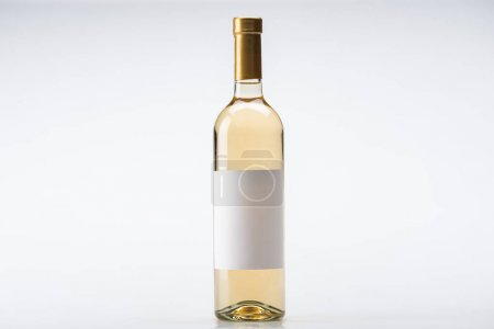 Photo for Bottle of white wine with blank label on white background - Royalty Free Image