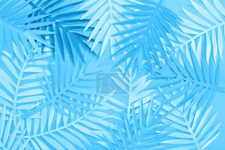 Photo for Top view of paper leaves on blue minimalistic background - Royalty Free Image