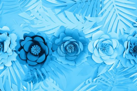 Photo for Flat lay with paper cut leaves and flowers on blue  background - Royalty Free Image