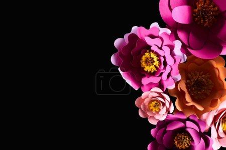 Foto de Vista superior de flores multicolores cortadas en papel aisladas en negro con espacio de copia - Imagen libre de derechos