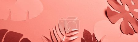 Photo for Panoramic shot of coral tropical paper cut palm leaves, minimalistic background with copy space - Royalty Free Image