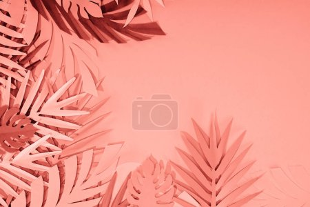 frame of coral tropical paper cut palm leaves, minimalistic background with copy space