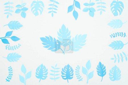 Foto de Vista superior de hojas cortadas de papel azul aisladas en blanco - Imagen libre de derechos