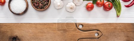 Photo for Panoramic shot of wooden chopping boards, garlics, salt, cherry tomatoes, chili peppers, spices and greenery - Royalty Free Image