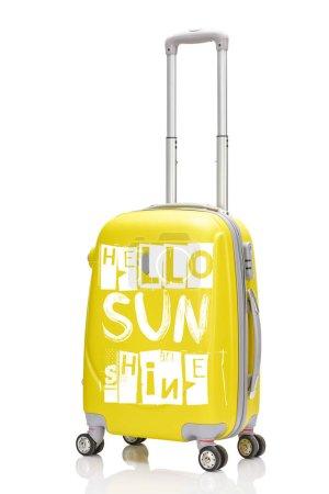 Photo pour Valise à roulettes en plastique jaune avec poignée et illustration Bonjour soleil isolée sur blanc - image libre de droit