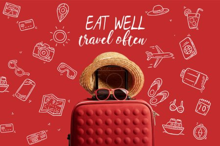 Photo for Red colorful travel bag with straw hat and sunglasses isolated on red with eat well, travel often illustration - Royalty Free Image
