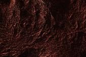 """Постер, картина, фотообои """"абстрактный фон серебряной текстурной мятой фольги с красным освещением"""""""