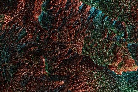 fondo abstracto de lámina arrugada texturizada con iluminación colorida