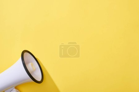 Photo for Top view of loudspeaker on yellow background with copy space - Royalty Free Image
