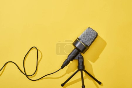 top view of microphone on bright and colorful background