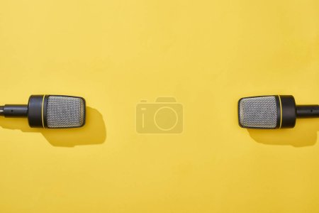 Photo for Top view of microphones on bright and colorful background - Royalty Free Image