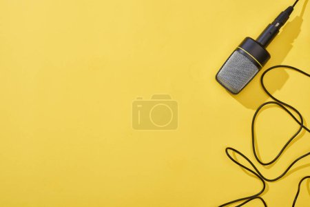 Photo for Top view of microphone on bright and colorful background - Royalty Free Image