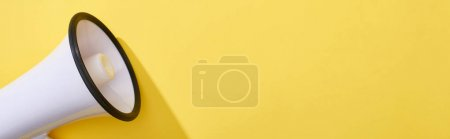 Photo for Panoramic shot of loudspeaker on bright and colorful background - Royalty Free Image