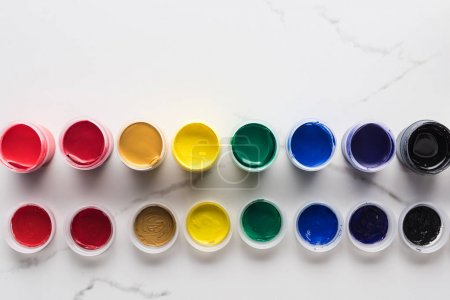 Photo for Flat lay with multicolored gouache paints on marble white surface - Royalty Free Image