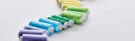 Photo for Panoramic shot of bright and colorful threads on white background - Royalty Free Image