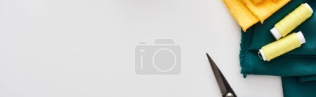 Photo for Panoramic shot of fabric, scissors and threads on white background - Royalty Free Image