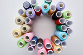 "Постер, картина, фотообои ""top view of bright and colorful threads on white background """