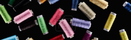 Photo for Panoramic shot of bright and colorful threads isolated on black - Royalty Free Image