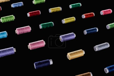 Photo for Blue, gray, green, pink, purple, red, yellow threads isolated on black - Royalty Free Image