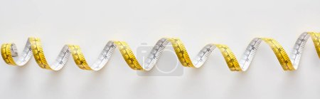 panoramic shot of colorful measuring tape on white background