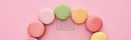 Photo for Frame of delicious French macaroons on pink background, panoramic shot - Royalty Free Image