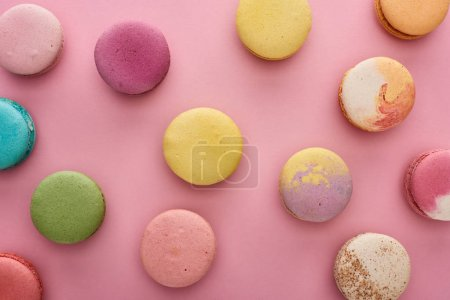 Photo for Background pattern with multicolored delicious French macaroons on pink - Royalty Free Image
