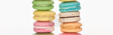 Photo for Rows of delicious French macaroons of different flavors isolated on white, panoramic shot - Royalty Free Image