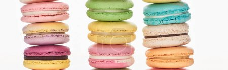 Photo for Rows of tasty colorful French macaroons of different flavors isolated on white, panoramic shot - Royalty Free Image